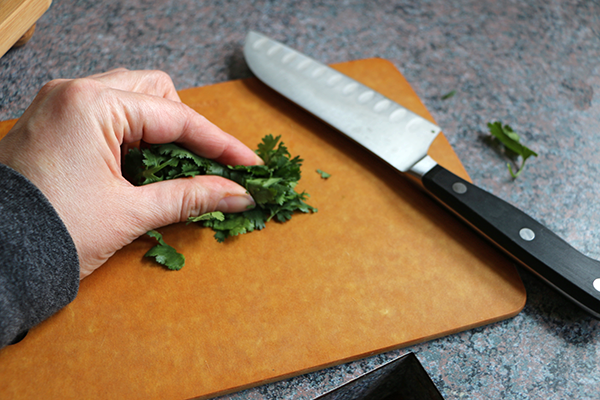 Cutting herbs for infused water ice cubes