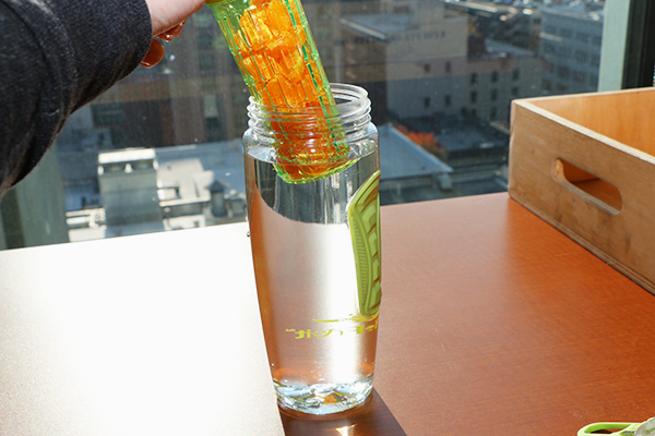 Tips for making infused waters. Lower the fruit into the water...